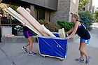 August 17, 2012; Members of the Pasquerilla Hall West orientation staff help with move in.  Photo by Barbara Johnston/University of Notre Dame