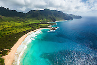 An aerial view of a long stretch of beach on Kaua'i.