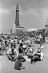 Crowded beach and Blackpool Tower, Blackpool, Lancashire.  1974