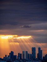 Sunset and sun-rays over Makati skyline, Manila, Philippines
