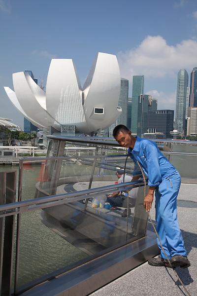 Modern bridge architecture Singapore walkway Marina Bay Sands clean repair maintenace worker