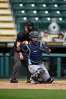 Charlotte Stone Crabs catcher Ronaldo Hernandez (27) throws the ball back to the pitcher in front of umpire Tanner Dobson during a Florida State League game against the Bradenton Marauders on April 10, 2019 at LECOM Park in Bradenton, Florida.  Bradenton defeated Charlotte 2-1.  (Mike Janes/Four Seam Images)