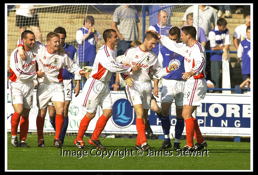 14/9/02       Copyright Pic : James Stewart                     .File Name : stewart-qots v inverness 13.DENNIS WYNESS (SECOND RIGHT) IS CONGRATULATED AFTER HE SCORED CALEY'S THIRD GOAL...James Stewart Photo Agency, 19 Carronlea Drive, Falkirk. FK2 8DN      Vat Reg No. 607 6932 25.Office : +44 (0)1324 570906     .Mobile : + 44 (0)7721 416997.Fax     :  +44 (0)1324 570906.E-mail : jim@jspa.co.uk.If you require further information then contact Jim Stewart on any of the numbers above.........