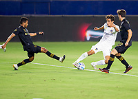 CARSON, CA - SEPTEMBER 06: Ethan Zubak #29 of the Los Angeles Galaxy turns past Jose Cifuentes #11 & Francisco Ginella #8  of LAFC during a game between Los Angeles FC and Los Angeles Galaxy at Dignity Health Sports Park on September 06, 2020 in Carson, California.