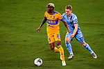 Midfielder Luis Quinones of Tigres UANL (MEX) moves the ball up against Gary Mackay-Steven of New York City FC (USA) during their Scotiabank Concacaf Champions League match at the Orlando's Exploria Stadium on 15 December 2020, in Florida. Photo by Victor Fraile / Power Sport Images