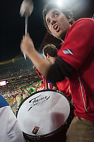 A Chile fan beats on his drum before a 2010 World Cup match against Brazil.  Chilie played Brazil at Ellis Park in Johannesburg, South Africa on Monday, June 28, 2010.  Brazil defeated Chilie 3-0.