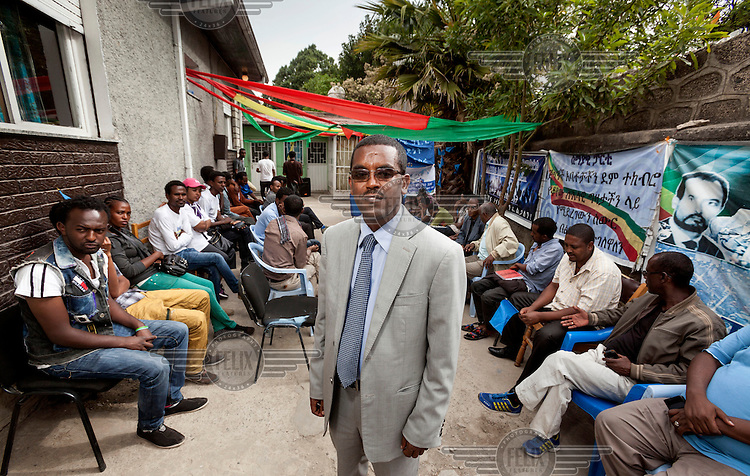 Yilkal Getent, Party Chairman of the Semayawi (Blue) Party, one of Ethiopia's few remaining opposition parties, at a local party meeting, in front of an election poster. Ethiopia is having a national election on 22 May 2015.