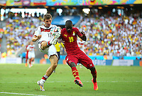 Thomas Muller of Germany and Jonathan Mensah of Ghana in action