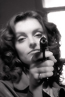Woman with pistol in her hand