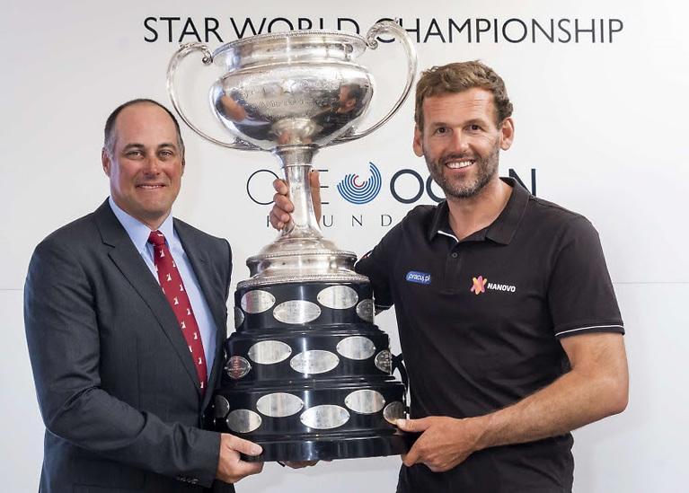 The Star World Championship Cup with the 2019 Star World Champions Mateusz Kusnierewicz (POL) (right) and Bruno Prada (BRA)