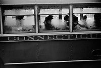 Passengers Anonymous: People in a bus on rainy day in Norwich, Connecticut. November, 1940.<br /> <br /> Photo by Jack Delano.