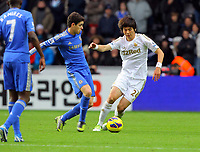 Saturday, 03 November 2012<br /> Pictured: Ki Sung Yueng of Swansea (R) against Oscar of Chelsea (L)<br /> Re: Barclays Premier League, Swansea City FC v Chelsea at the Liberty Stadium, south Wales.