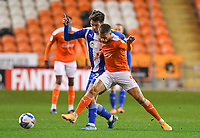 Blackpool's Jerry Yates battles with Wigan Athletic's Alex Perry<br /> <br /> Photographer Dave Howarth/CameraSport<br /> <br /> The EFL Sky Bet League One - Blackpool v Wigan Athletic - Tuesday 3rd November 2020 - Bloomfield Road - Blackpool<br /> <br /> World Copyright © 2020 CameraSport. All rights reserved. 43 Linden Ave. Countesthorpe. Leicester. England. LE8 5PG - Tel: +44 (0) 116 277 4147 - admin@camerasport.com - www.camerasport.com