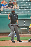 Umpire Derek Eaton handles the calls behind the plate during the game between the Salt Lake Bees and the Tacoma Rainiers at Smith's Ballpark on May 16, 2021 in Salt Lake City, Utah. The Bees defeated the Rainiers 8-7. (Stephen Smith/Four Seam Images)