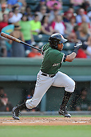 Right fielder Junior Arias (12) of the Augusta GreenJackets bats in a game against the Greenville Drive on Thursday, June 9, 2016, at Fluor Field at the West End in Greenville, South Carolina. Augusta won, 8-2. (Tom Priddy/Four Seam Images)