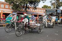 Jaipur, Rajasthan, India.  Street Traffic; Rickshaws Carry People, Deliver Goods.