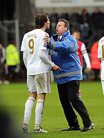Pictured: Michu of Swansea (9) is held back by a stadium steward during what seems to be a verbal argument with Arsenal goalkeeper Lukasz Fabianski (not pictured).  Saturday 16 March 2013<br /> Re: Barclay's Premier League, Swansea City FC v Arsenal at the Liberty Stadium, south Wales.