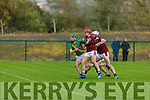Kilmoyley's Daire Nolan attempts to break free from the challenges of Causeway's Anthony Fealy and Keith Carmody in the North Kerry Senior Hurling Championship final