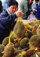 San Francisco, California, USA. Chinatown. Buying a Durian from a Sidewalk Vendor.
