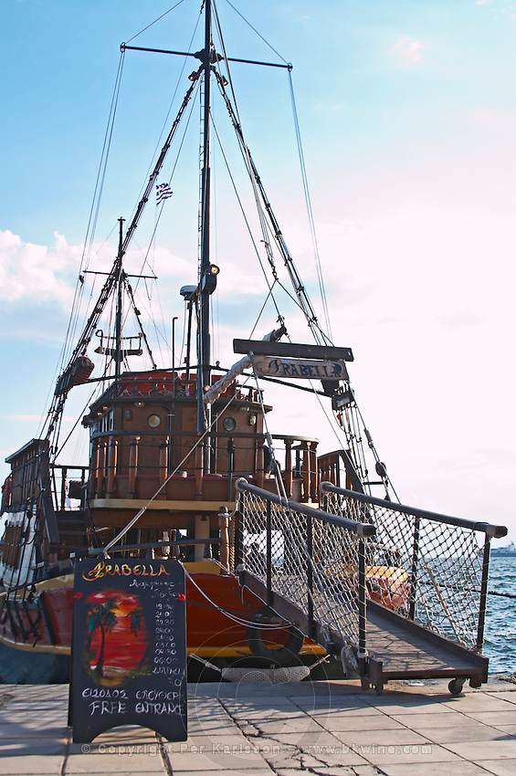 An old ship converted to a sailing bar and cafe in the harbour. Thessaloniki, Macedonia, Greece