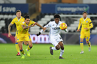 Daniel Leadbitter of Bristol Rovers vies for possession with Jordon Garrick of Swansea City U21 during the Checkatrade Trophy match between Swansea City U21 and Bristol Rovers at the Liberty Stadium in Swansea, Wales, UK. Wednesday 05 December 2018