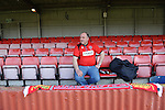Stamford AFC 2 Marine 4, 29/03/2014. Wothorpe Road, Northern Premier League. A Stamford supporter finds his seat early in time for The Northern Premier League game between Stamford AFC and Marine from The Daniels Stadium. Marine won the game 4-2 in front of 320 supporters to boost their chances of relegation survival. Stamford AFC are moving to the brand new Zeeco Stadium at the end of the 2013/14 season Photo by Simon Gill.