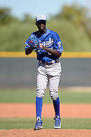 Kansas City Royals pitcher Yunior Marte (61) during an instructional league game against the Seattle Mariners on October 2, 2013 at Surprise Stadium Training Complex in Surprise, Arizona.  (Mike Janes/Four Seam Images)