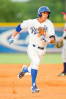 Mark Threlkeld (26) of the Burlington Royals hustles towards third base against the Danville Braves at Burlington Athletic Park on July 19, 2012 in Burlington, North Carolina.  The Royals defeated the Braves 4-3.  (Brian Westerholt/Four Seam Images)