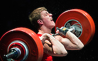 10 MAY 2014 - COVENTRY, GBR - Gwilym Pari from the Holyhead and Anglesey Weightlifting and Fitness Club  attempts to complete a lift during the men's 77kg A category round at the British 2014 Senior Weightlifting Championships and final 2014 Commonwealth Games qualifying event round at the Ricoh Arena in Coventry, Great Britain(PHOTO COPYRIGHT © 2014 NIGEL FARROW, ALL RIGHTS RESERVED)