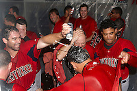 Pawtucket Red Sox coaches have beer poured over their head by Dan Butler, Tony Pena Jr. and other teammates after game four of a best of five playoff series against the Empire State Yankees at Frontier Field on September 8, 2012 in Rochester, New York.  Pawtucket defeated Empire State 7-1 to advance to the International League Finals.  (Mike Janes/Four Seam Images)