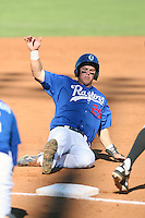 Joc Pederson #29 of the Ogden Raptors slides safely into third base during a game against the Idaho Falls Chukars in a Pioneer League game at Lindquist Field on September 4, 2011 in Ogden, Utah. (Bill Mitchell/Four Seam Images)