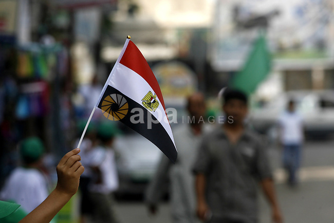 Palestinian boys supporter hold up Egyptian flags as they celebrate in Rafah, in the southern Gaza Strip, 19 June 2012. Egypt's Muslim Brotherhood claimed on 18 June 2012 victory in Egypt's first presidential election since Hosni Mubarak was ousted more than a year ago. The Brotherhood reported on its website that its candidate Mohamed Morsi won 52 per cent of the voted in weekend elections, with ballots at 95 per cent of polling stations counted. Photo by Eyad Al Baba