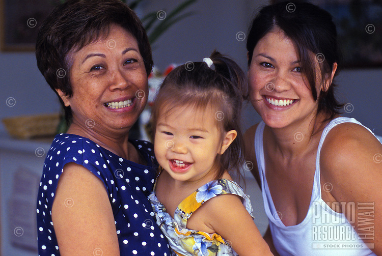 Mother, daughter and Auntie smiling for the camera
