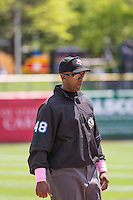 Base umpire A.J.Johnson handles the calls on the bases  of the Salt Lake Bees game against the Reno Aces in Pacific Coast League action at Smith's Ballpark on May 10, 2015 in Salt Lake City, Utah.  Salt Lake defeated Reno 9-2 in Game One of the double-header. (Stephen Smith/Four Seam Images)