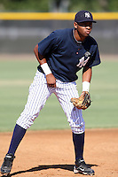 New York Yankees minor league third baseman Jorge Alcantara (21) vs. the Pittsburgh Pirates in an Instructional League game at the New York Yankees Minor League Complex in Tampa, Florida;  October 8, 2010.  Photo By Mike Janes/Four Seam Images