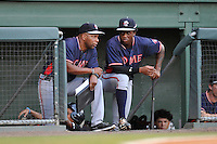 Shortstop Anfernee Seymour (27) of the Rome Braves, right, consults with coach Bobby Moore (1) in a game against the Greenville Drive on Tuesday, August 30, 2016, at Fluor Field at the West End in Greenville, South Carolina. Greenville won, 7-3. (Tom Priddy/Four Seam Images)