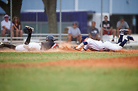 Western Connecticut Colonials third baseman Bill Buscetto (16) makes a diving attempt to tag Jonathan Roehler (9) diving back to third base during the first game of a doubleheader against the Edgewood College Eagles on March 13, 2017 at the Lee County Player Development Complex in Fort Myers, Florida.  Edgewood defeated Western Connecticut 3-0.  (Mike Janes/Four Seam Images)
