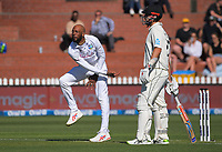 Roston Chase bowls past NZ's Daryl Mitchell during day one of the International Test Cricket match between the New Zealand Black Caps and West Indies at the Basin Reserve in Wellington, New Zealand on Friday, 11 December 2020. Photo: Dave Lintott / lintottphoto.co.nz