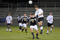 Patrick O'Neil (18) of the Princeton Tigers goes for a header over Chris Williams (3) of the UMBC Retrievers. UMBC Retrievers defeated Princeton Tigers 2-1 during the first round of the 2010 NCAA Division 1 Men's Soccer Championship at Roberts Stadium in Princeton, NJ, on November 18, 2010.