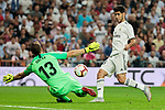 Real Madrid's Marco Asensio and Atletico de Madrid's Jan Oblak during La Liga match between Real Madrid and Atletico de Madrid at Santiago Bernabeu Stadium in Madrid, Spain. September 29, 2018. (ALTERPHOTOS/A. Perez Meca)