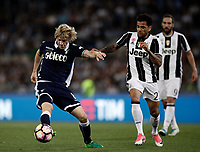 Calcio, Tim Cup: finale Juventus vs Lazio. Roma, stadio Olimpico, 17 maggio 2017.<br /> Lazio's Dusan Basta, left, is challenged by Juventus' Dani Alves during the Italian Cup football final match between Juventus and Lazio at Rome's Olympic stadium, 17 May 2017.<br /> UPDATE IMAGES PRESS/Isabella Bonotto