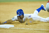 Jose Marquez (4) of the Burlington Royals slides head-first into third base during the game against the Johnson City Cardinals at Burlington Athletic Stadium on July 15, 2018 in Burlington, North Carolina. The Cardinals defeated the Royals 7-6.  (Brian Westerholt/Four Seam Images)
