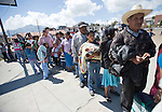 Residents in San Marcos affected by earthquake wait in the line to receive food at emergency food distribution by government in San Marcos.
