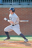 T.J. Sutton (5) of the Kent State Golden Flashes follows through on his swing against the Charlotte 49ers at Robert and Mariam Hayes Stadium on March 8, 2013 in Charlotte, North Carolina.  The 49ers defeated the Golden Flashes 5-4.  (Brian Westerholt/Four Seam Images)