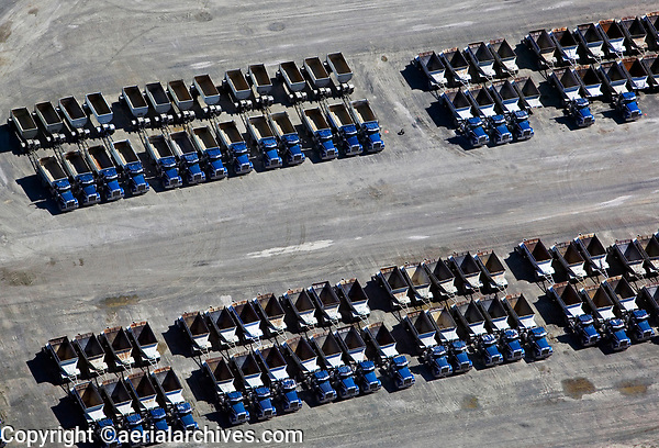 aerial photograph of numerous parked produce load hauling semi-trailer trucks in the California Central Valley