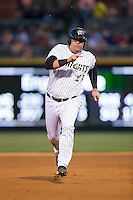 Dan Black (27) of the Charlotte Knights hustles towards third base against the Scranton\Wilkes-Barre RailRiders at BB&T BallPark on May 1, 2015 in Charlotte, North Carolina.  The RailRiders defeated the Knights 5-4.  (Brian Westerholt/Four Seam Images)
