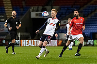 Bolton Wanderers' Ali Crawford controlling the ball ahead of Salford City's Jason Lowe (right) <br /> <br /> Photographer Andrew Kearns/CameraSport<br /> <br /> The EFL Sky Bet League Two - Bolton Wanderers v Salford City - Friday 13th November 2020 - University of Bolton Stadium - Bolton<br /> <br /> World Copyright © 2020 CameraSport. All rights reserved. 43 Linden Ave. Countesthorpe. Leicester. England. LE8 5PG - Tel: +44 (0) 116 277 4147 - admin@camerasport.com - www.camerasport.com