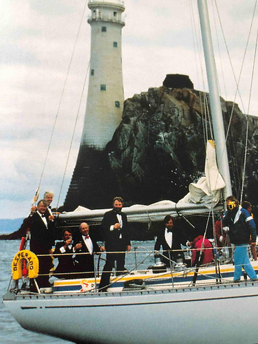 1991 - Celebrating rounding the Fastnet Rock in style aboard Richard Loftus' Swan 65 Desperado of Cowes