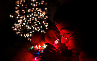 """""""Is it red?""""  Annabelle Costanzo, 12, asks of her mother, Gina, while looking at a set of Christmas lights in the living room of her Polk City home. She is putting her improving eyesight to the test each day since undergoing a cornea transplant in her left eye. She can see blue and red clearly now after only being able to see shades of gray before the transplant.  Blind since birth, she has undergone multiple eye surgeries that allow her to see shades of light."""
