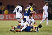 Cristiano Ronaldo (top) gets tangled up with Pavel Pardo (bottom). Real Madrid defeated Club America 3-2 at Candlestick Park in San Francisco, California on August 4th, 2010.